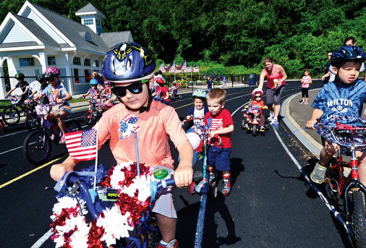 Hour photo / Erik Trautmann Children participate in the first ever Cannondale Bike Rodeo at Fujitani Field as part of Wilton's Independence Day festivities Saturday.