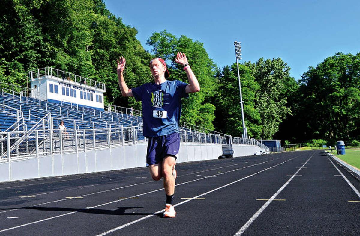 Hour photo / Erik Trautmann Aaron Breene wins the annual Freedom Run (5K) Road Race at Fujitani Field as part of Wilton's Independence Day festivities Saturday morning.