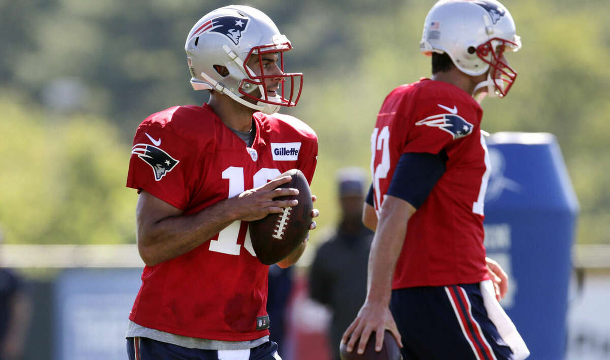 New England Patriots quarterback Jimmy Garoppolo looks to pass during an NFL football training camp in Foxborough, Mass., Friday, July 31, 2015. (AP Photo/Charles Krupa)