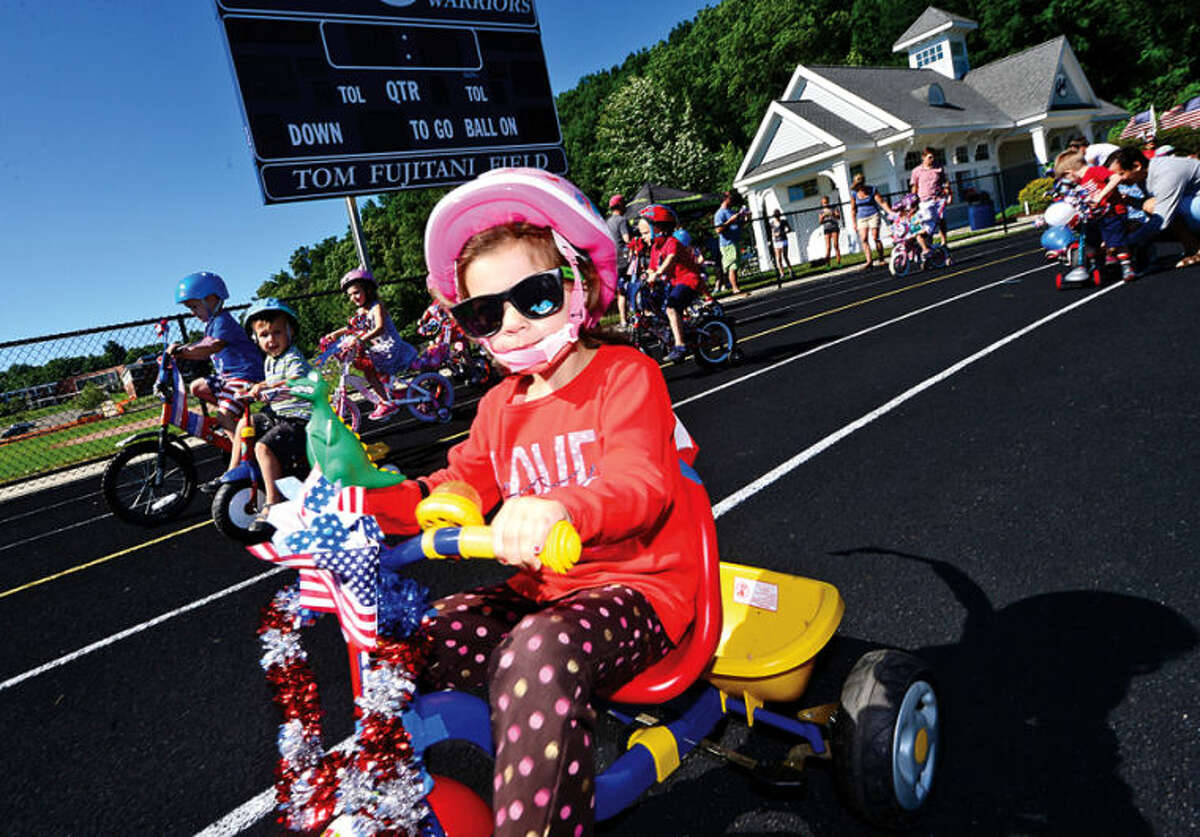 Hour photo / Erik Trautmann Sarah Viggiano participates in the Cannondale Bike Rodeo at Fujitani Field as part of Wilton's Independence Day festivities Saturday.