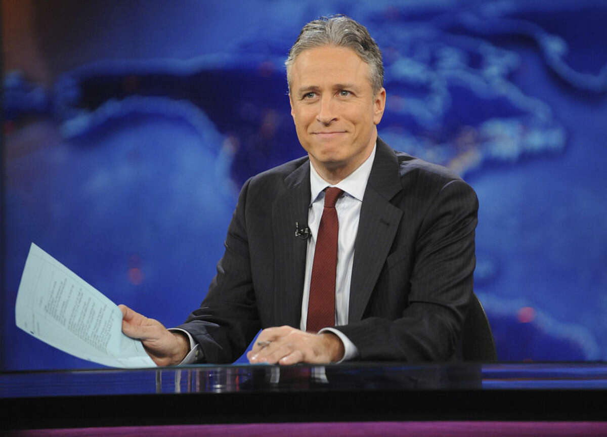 FILE - This Nov. 30, 2011 file photo shows television host Jon Stewart during a taping of