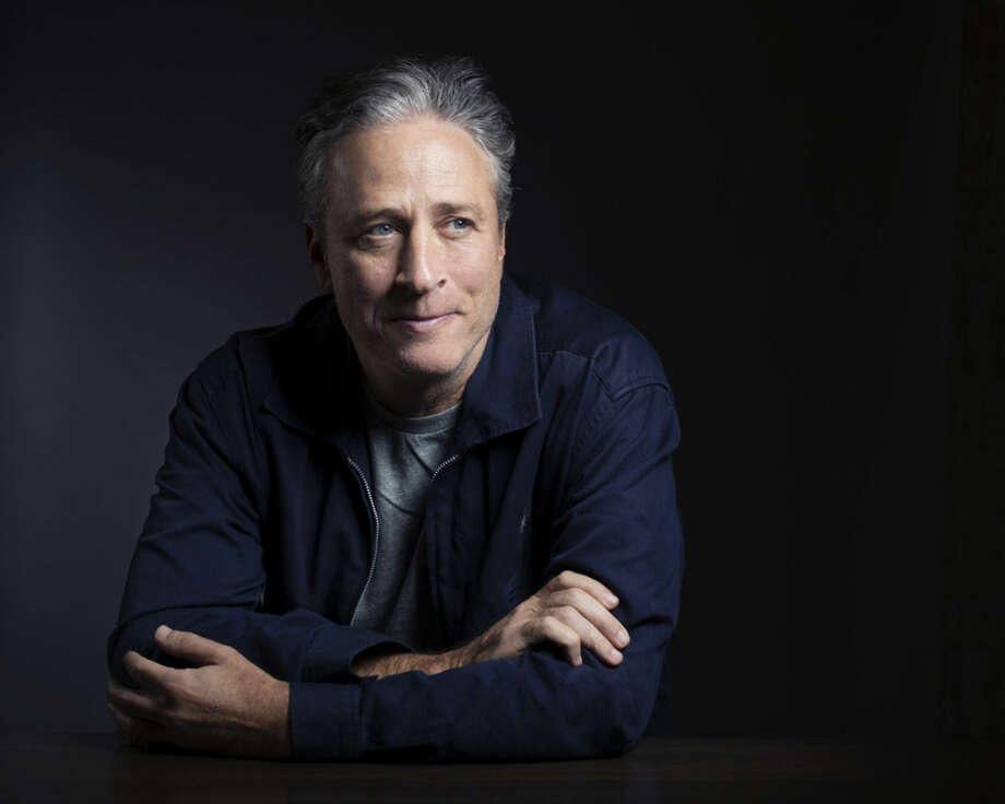 """FILE - In this Nov. 7, 2014 file photo, Jon Stewart poses for a portrait in promotion of his film,""""Rosewater,"""" in New York. Stewart says goodbye on Thursday, Aug. 6, 2015, after 16 years on Comedy Central's """"The Daily Show"""" that established him as America's foremost satirist of politicians and the media. (Photo by Victoria Will/Invision/AP, File)"""