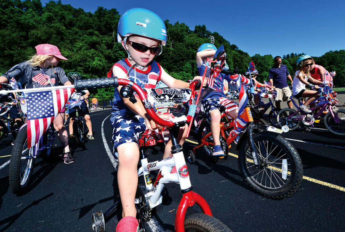 Hour photo / Erik Trautmann 3 year old Jack Major participates in the Cannondale Bike Rodeo at Fujitani Field as part of Wilton's Independence Day festivities Saturday.