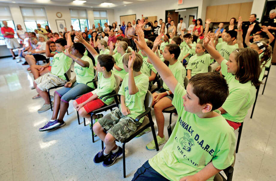 Hour photo / Erik Trautmann Children in the DARE camp mark their final day of camp with a graduation at the police headquarters Friday.