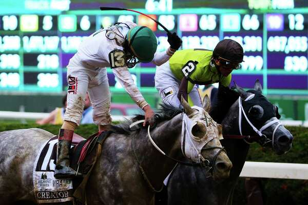 ELMONT, NY - JUNE 11:  Jockey Irad Ortiz Jr. celebrates atop Creator after winning the The 148th running of the Belmont Stakes at Belmont Park on June 11, 2016 in Elmont, New York.  (Photo by Mike Stobe/Getty Images) ORG XMIT: 637228051