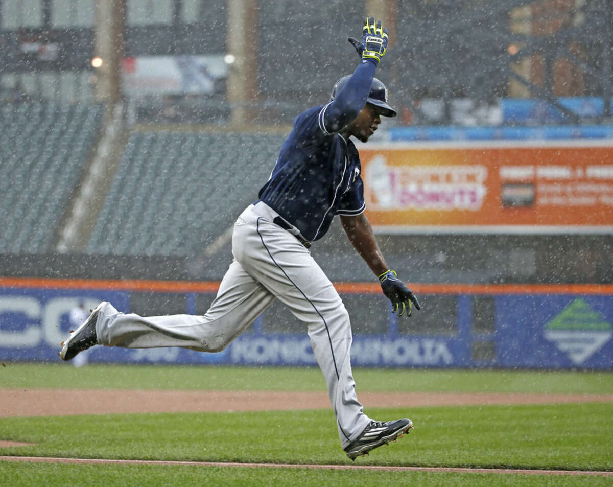 San Diego Padres' Justin Upton celebrates running between third and home plate after hitting a ninth-inning, three-run home run off New York Mets relief pitcher Jeurys Familia in a rain-delayed baseball game in New York, Thursday, July 30, 2015. (AP Photo/Kathy Willens)