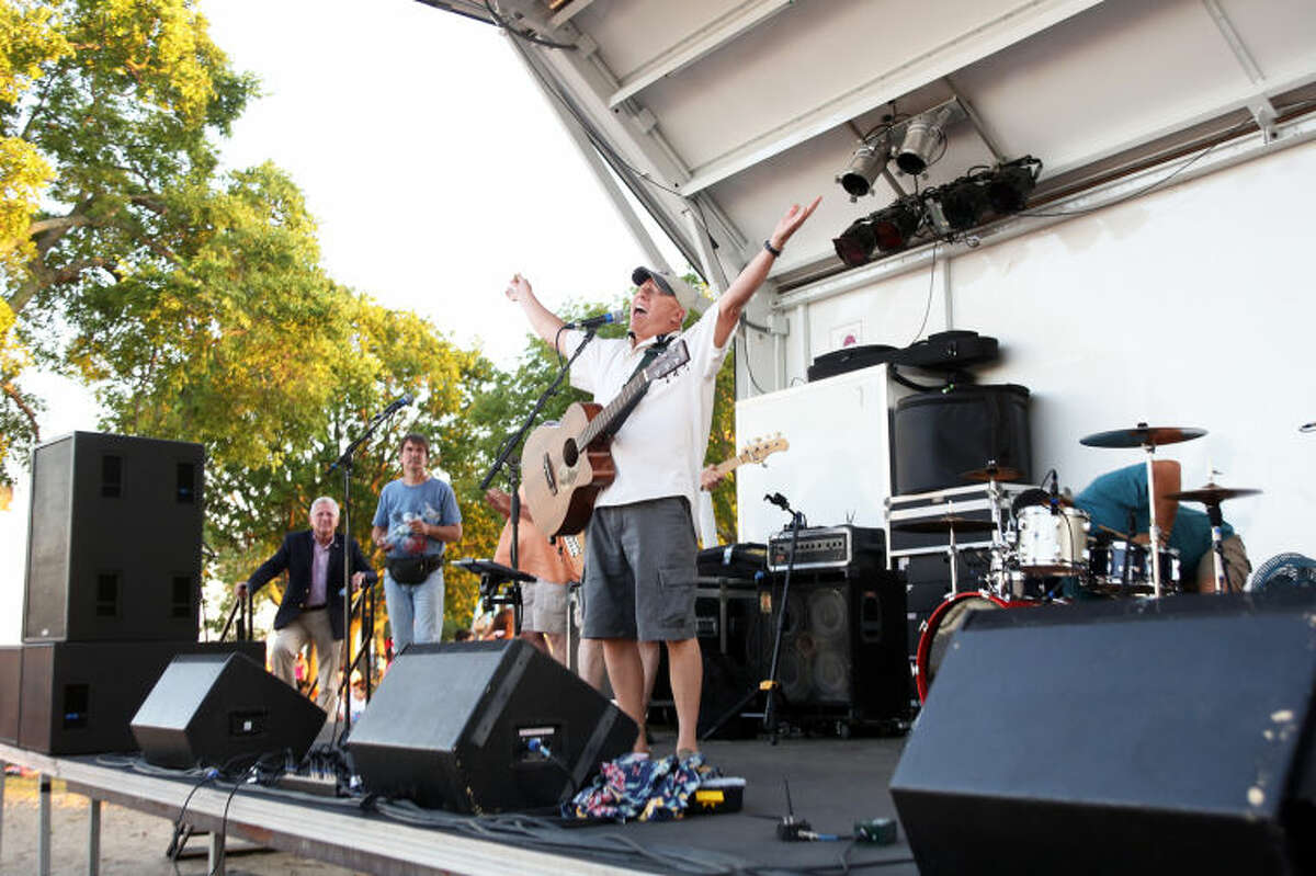 Jimmy & The Parrots perform before Norwalk's annual firework display at Shady Beach Saturday evening. Hour Photo / Danielle Calloway