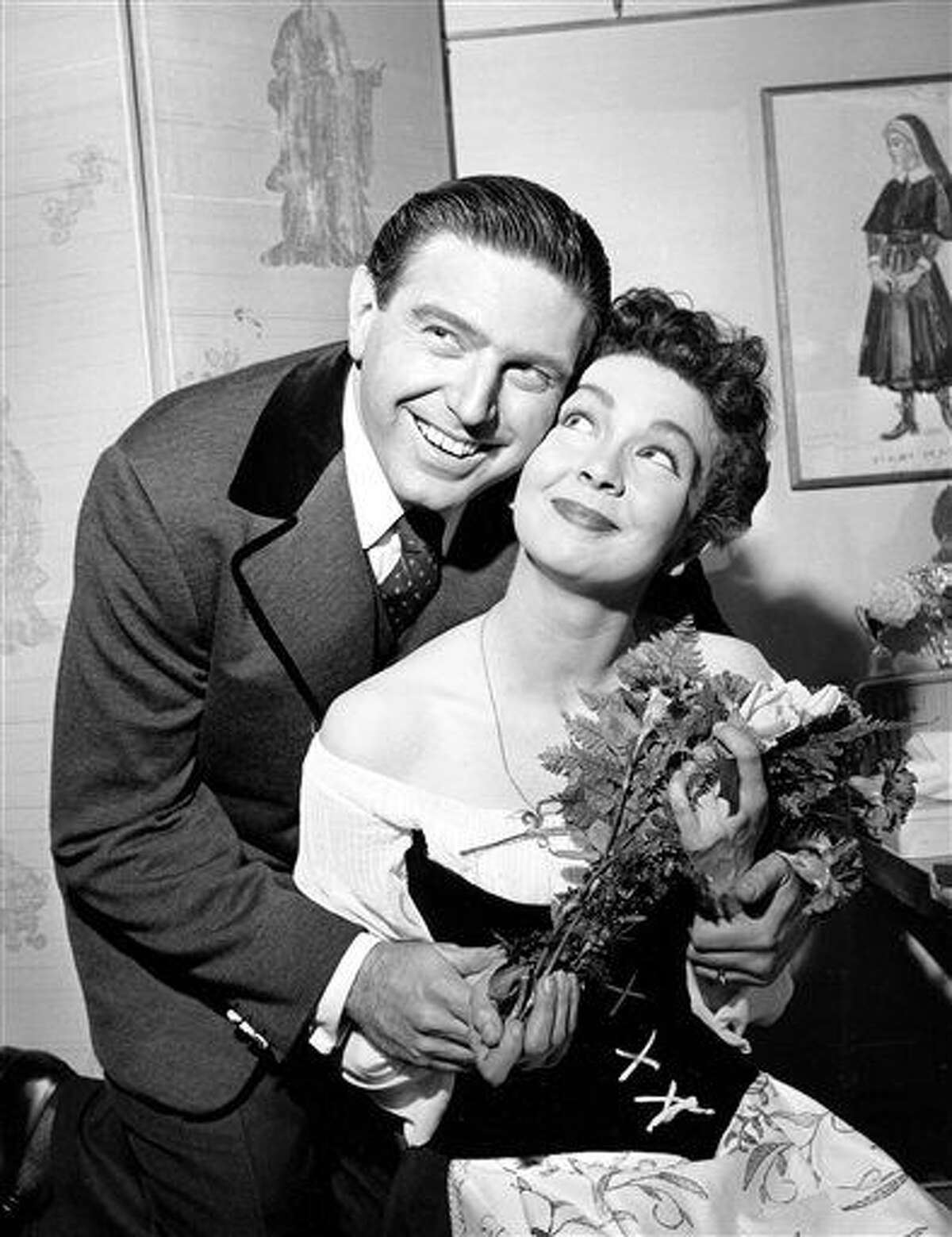 CORRECTS DATE OF DEATH TO TUESDAY, JULY 21 - FILE - In this May 12, 1960 file photo, Renee Guerin, of Juneau, Alaska, poses with her costar Theodore Bikel after their performance of