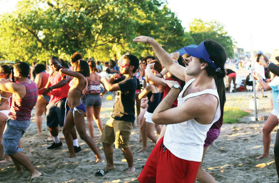 "Steven Bravo does the ""wobble"" before Norwalk's annual firework display at Shady Beach Saturday evening. Hour Photo / Danielle Calloway"