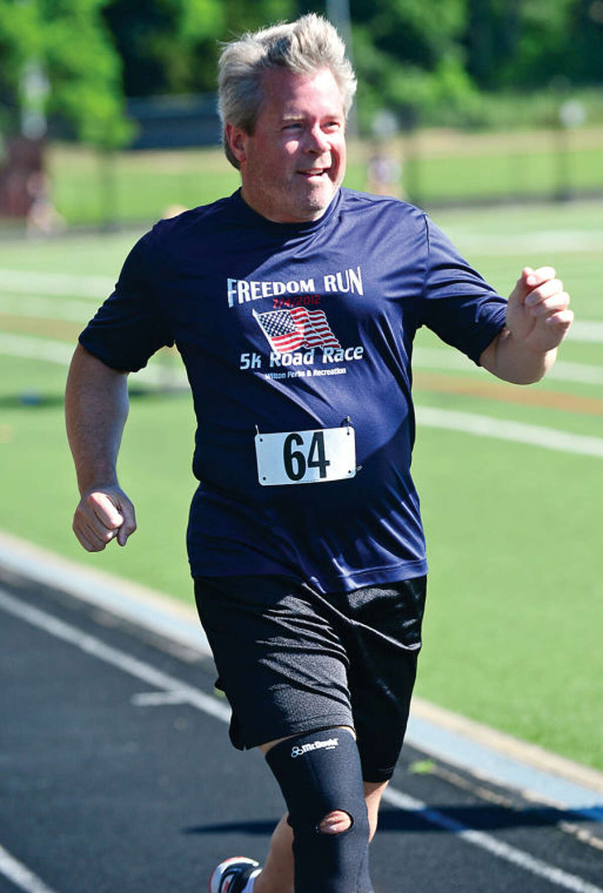 Hour photo / Erik Trautmann Thom Healy has been running in the annual Freedom Run (5K) Road Race for over 10 years. The race is part of Wilton's Independence Day festivities Saturday morning.