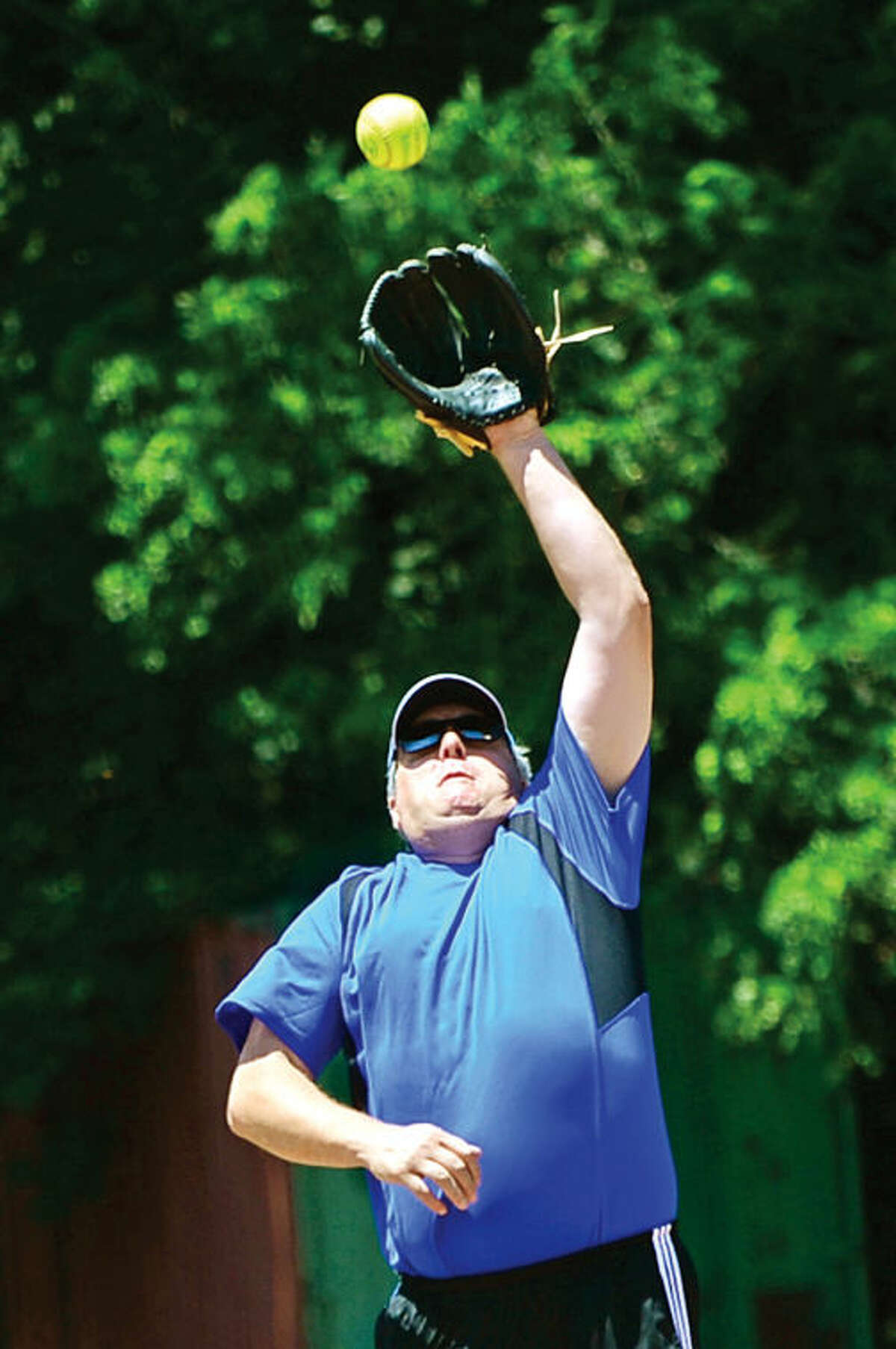 Hour photo / Erik Trautmann Democrat Crian Lilly snags a fly ball during the annual Wilton Political softball game where town Republicans play Democrats for the Frivolity Cup as part of Wilton's Independence Day Celebration.