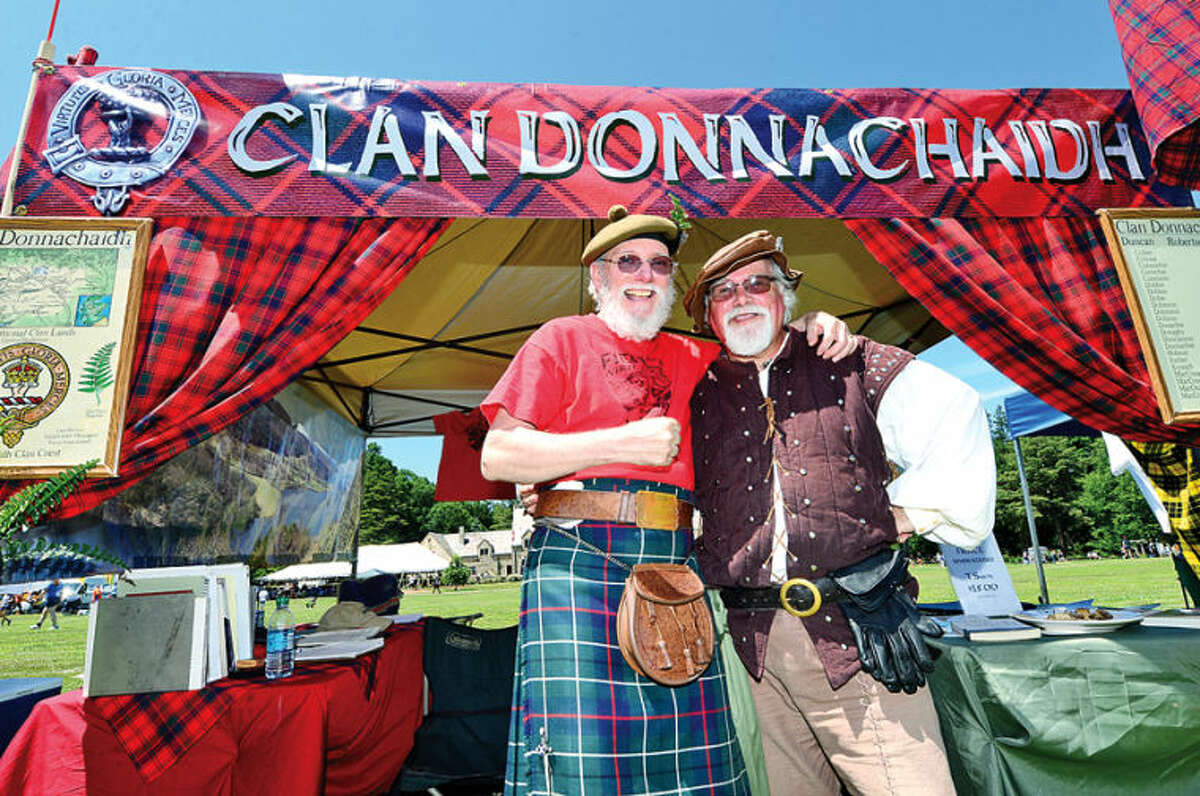 Hour photo / Erik Trautmann Scott Duncan from Clan Donnachaih and Harold McCumber from Clan Armstrong get together at the Clan Village during the 91st Annual Round Hill Highland Games at Cranbury Park Saturday.