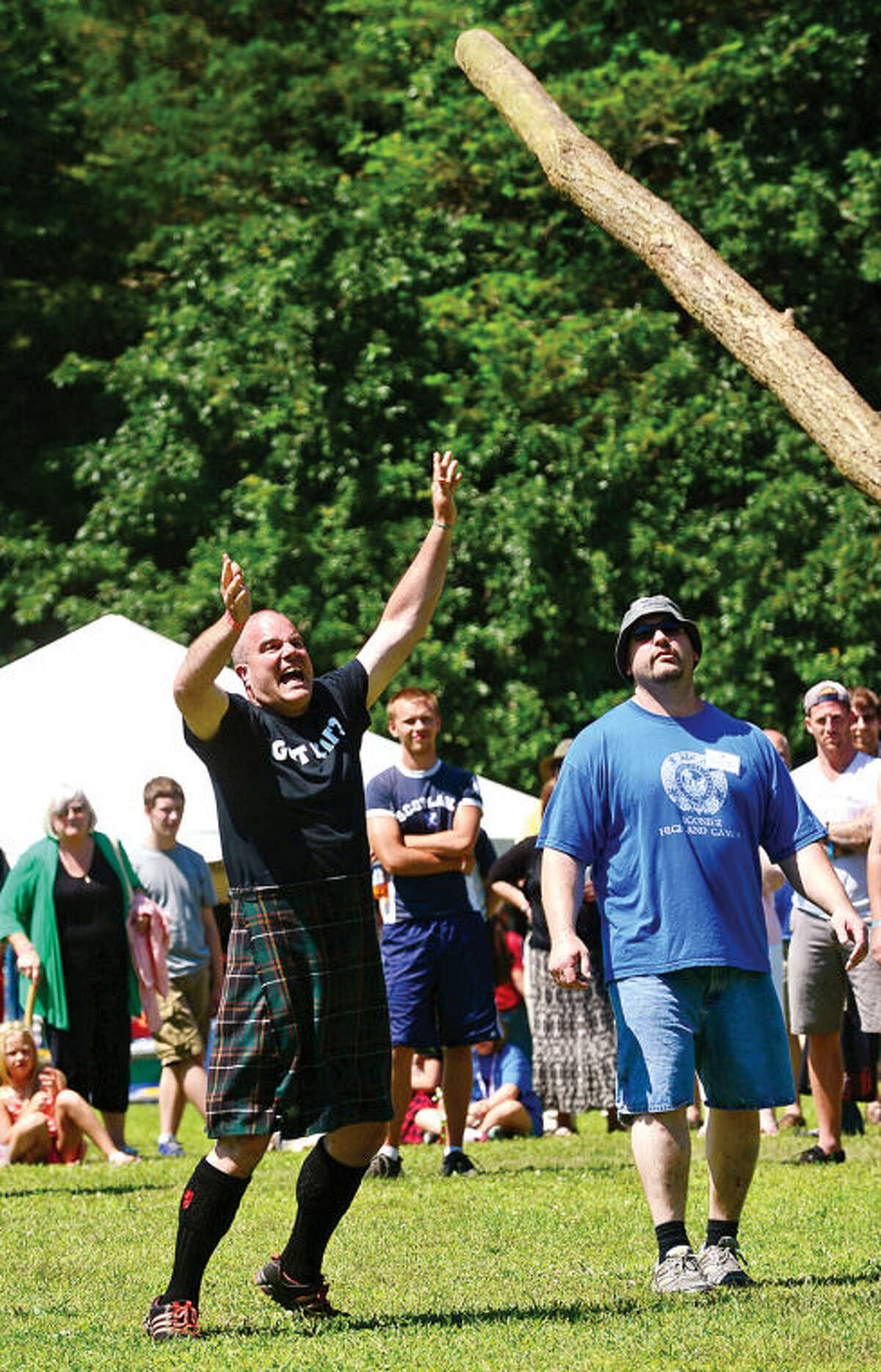 Hour photo / Erik Trautmann Pat Borden tosses the Taber during the 91st Annual Round Hill Highland Games at Cranbury Park Saturday.
