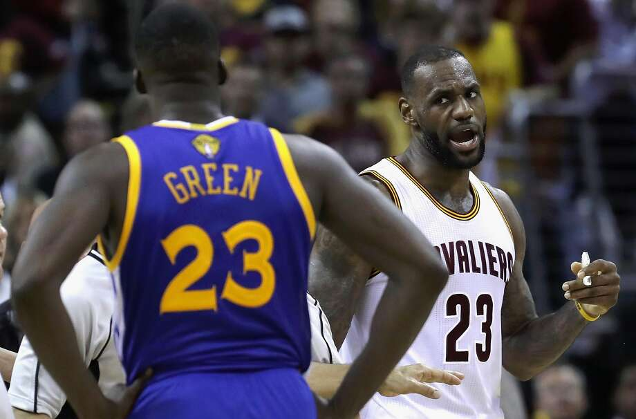 LeBron James and Draymond Green exchange words during a time out during the fourth quarter in Game 4 of the NBA Finals at Quicken Loans Arena in Cleveland, Ohio.  Photo: Ronald Martinez, Getty Images