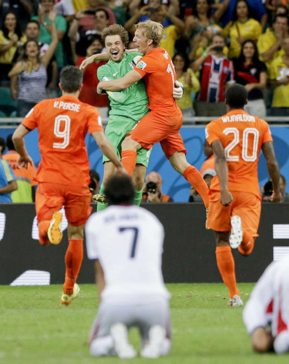 Netherlands' goalkeeper Tim Krul, center left, celebrates after making the final save in a penalty shoot out during the World Cup quarterfinal soccer match between the Netherlands and Costa Rica at the Arena Fonte Nova in Salvador, Brazil, Saturday, July 5, 2014. The Netherlands won 4-3 0n penalties after the match ended 0-0 after extra time. (AP Photo/Matt Dunham)