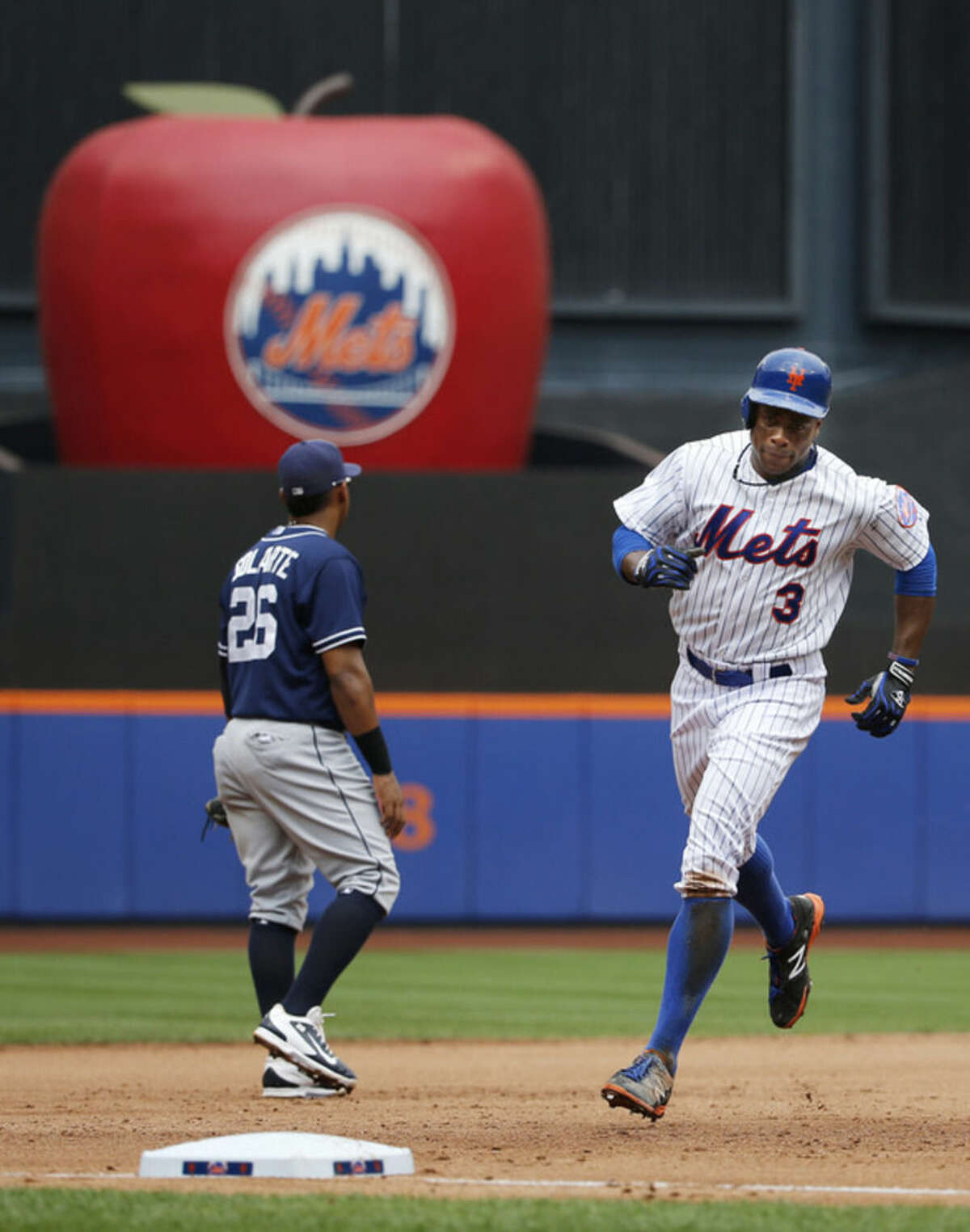New York Mets' Curtis Granderson (3) runs the bases past San Diego Padres third baseman Yangervis Solarte after hitting a fifth-inning, three-run, home run in a baseball game in New York, Thursday, July 30, 2015. (AP Photo/Kathy Willens)