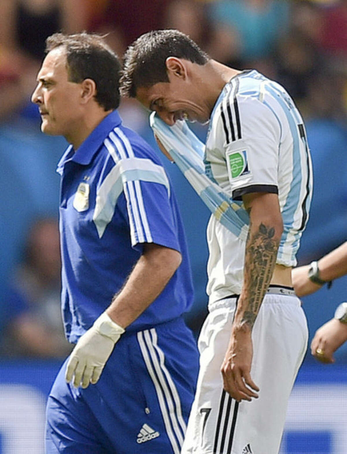 Argentina's Angel di Maria, right, leaves the field with an injury during the World Cup quarterfinal soccer match between Argentina and Belgium at the Estadio Nacional in Brasilia, Brazil, Saturday, July 5, 2014. (AP Photo/Martin Meissner)