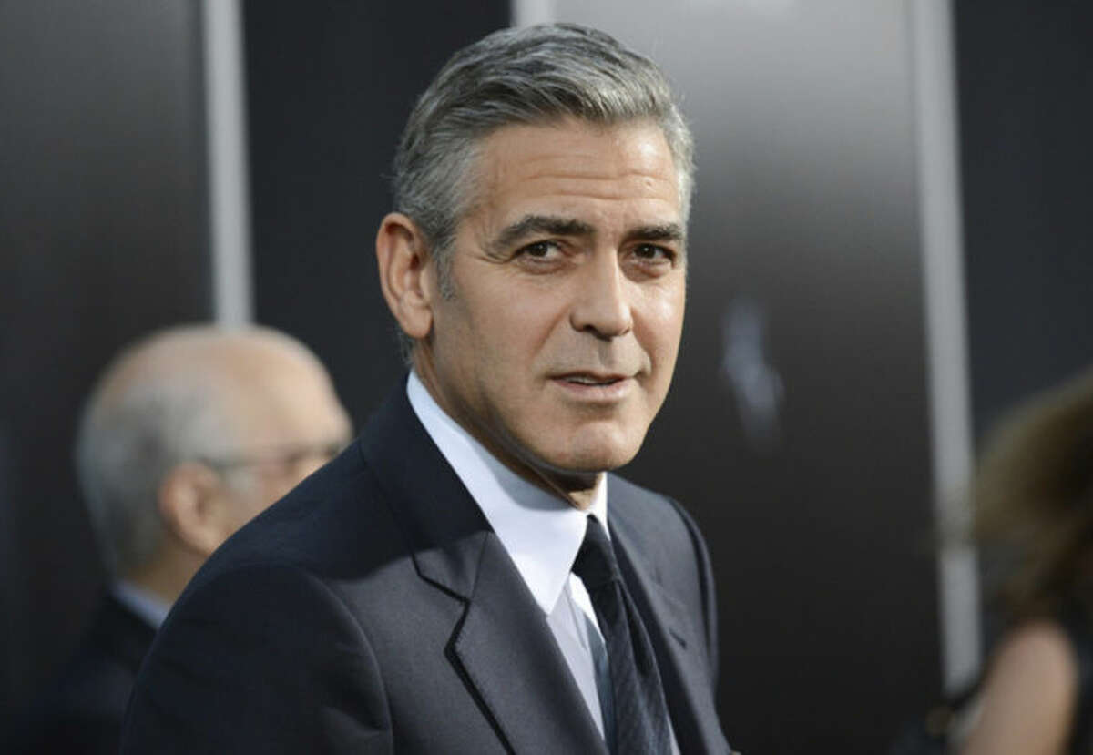 FILE - In this Oct. 1, 2013 file photo actor George Clooney attends the premiere of