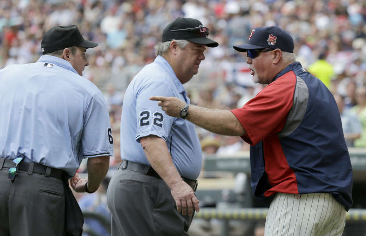 Minnesota Twins manager Ron Gardenhire, right, argues with home plate umpire Marty Foster, left, and third base umpire Joe West, center, and is ejected from the game during the third inning of a baseball game against the New York Yankees in Minneapolis, Saturday, July 5, 2014. (AP Photo/Ann Heisenfelt)