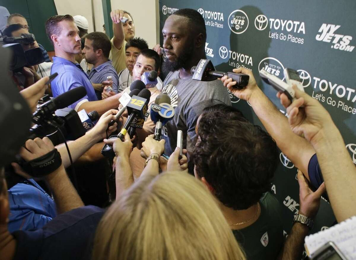 New York Jets defensive end Muhammad Wilkerson responds to questions during a news interview after practice at training camp, Thursday, July 30, 2015, in Florham Park, N.J. (AP Photo/Frank Franklin II)