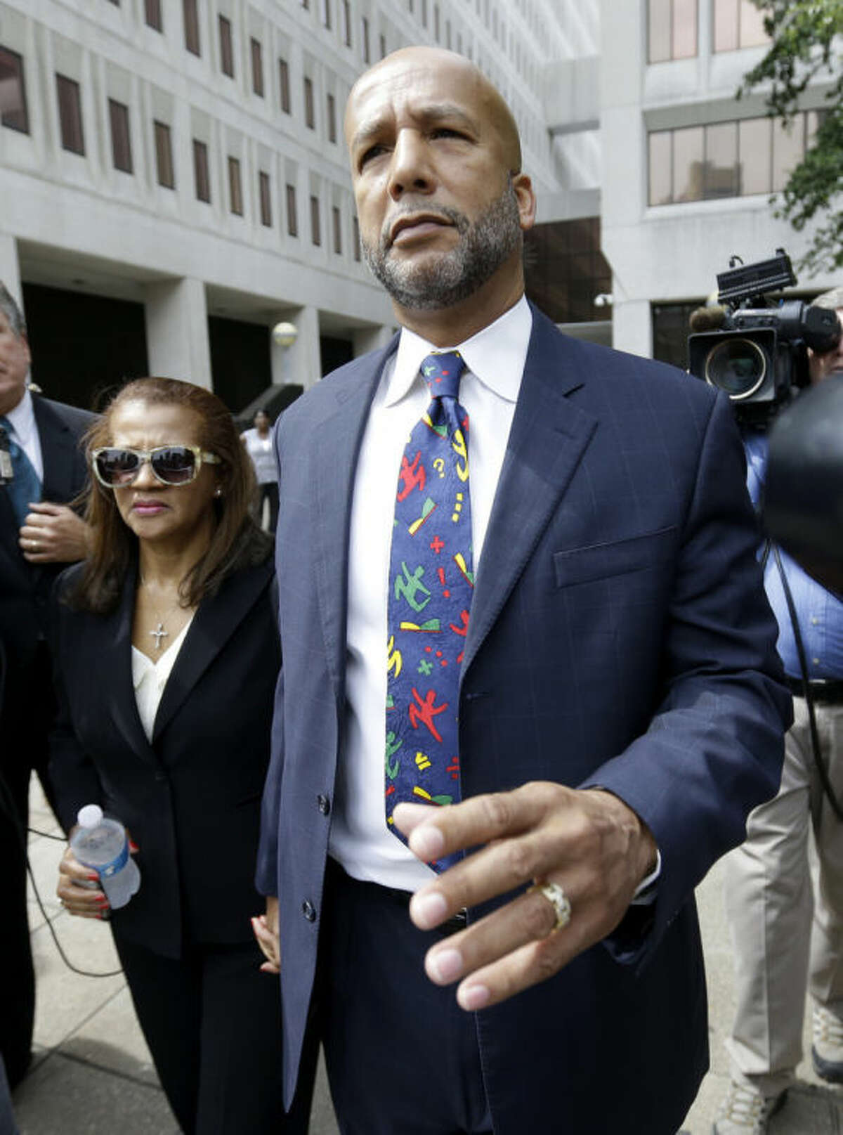 Former New Orleans Mayor Ray Nagin leaves federal court after being sentenced in New Orleans, Wednesday, July 9, 2014. Nagin was sentenced to 10 years in prison for bribery, money laundering and other corruption that spanned his two terms as mayor, including the chaotic years after Hurricane Katrina hit in 2005. He was convicted Feb. 12 of accepting hundreds of thousands of dollars from businessmen who wanted work from the city or Nagin's support for various projects. The bribes came in the form of money, free vacations and truckloads of free granite for his family business. (AP Photo/Gerald Herbert)