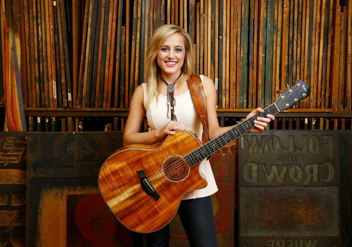 Photo by Donn Jones/Invision/AP This July 7, photo shows 19-year-old country singer Mary Sarah posing at Hatch Show Print inside The Country Music Hall of Fame and Museum in Nashville, Tenn. On Tuesday, July 8, Mary Sarah released a new album called