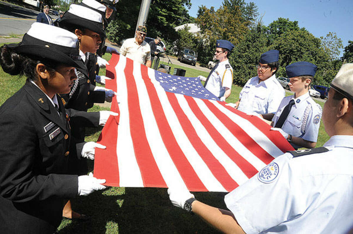 The Veteran of the month Flag ceremony at the American Legion Sunday in honor of Local business man and United States Air Force Korean War Veteran, Airman 1/CL Allen Donald Fedor. Hour photo Matthew Vinci