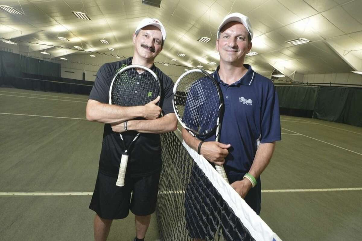 Hour photo/Alex von Kleydorff Angelo, right, and Ettore Rossetti both Tennis pros at Weston Raquet Club train to attemt a Guinness 'Most Volleys' world record.