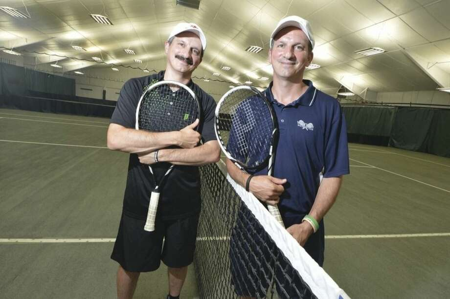 Hour photo/Alex von KleydorffAngelo, right, and Ettore Rossetti both Tennis pros at Weston Raquet Club train to attemt a Guinness 'Most Volleys' world record.