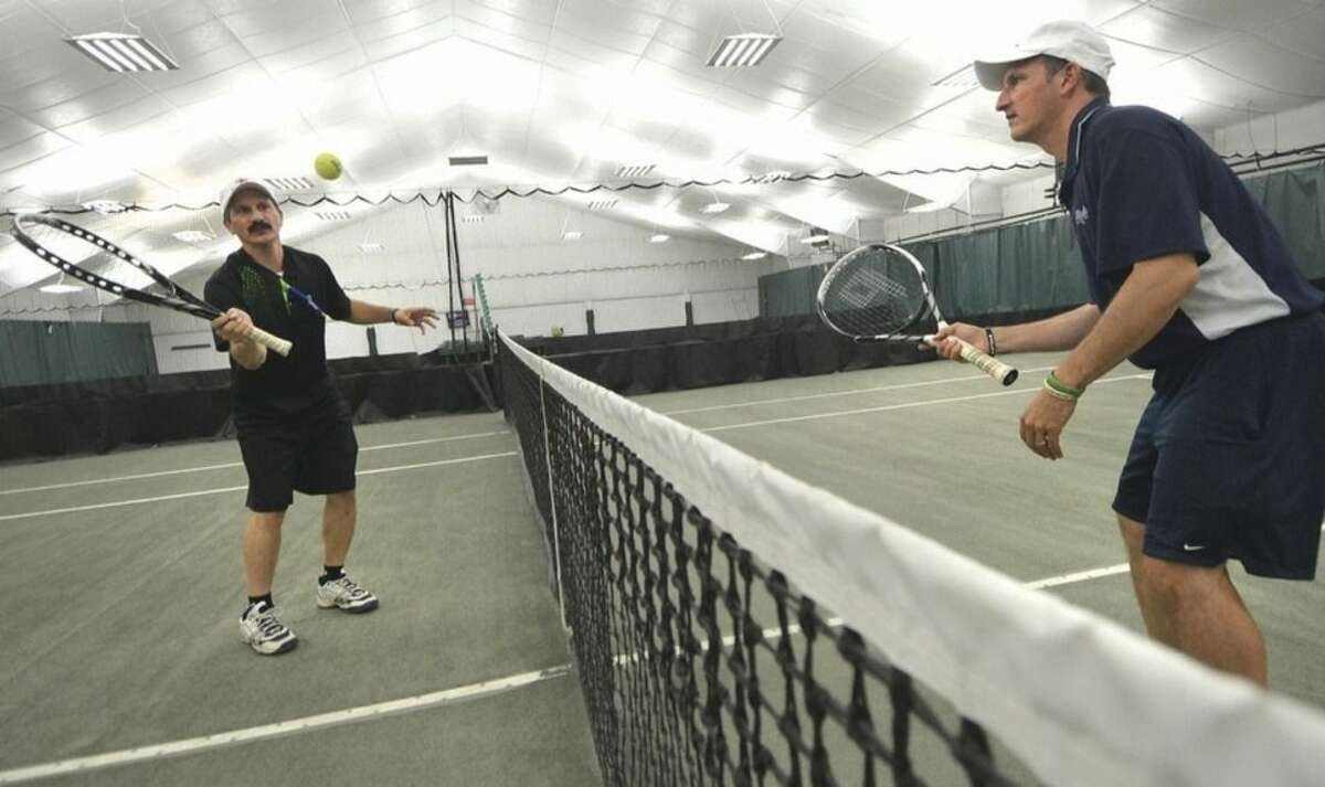 Hour photo/Alex von Kleydorff Angelo, right, and Ettore Rossetti both Tennis pro's at Weston Raquet Club train to attemt a Guinness 'Most Volleys' world record.