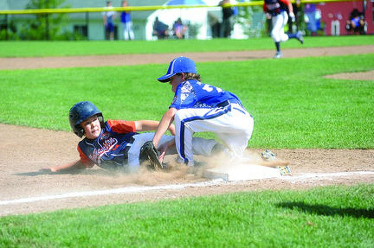 #22 Henry Feinstein tags ouut # 9 Hudson Fulcher-Melendy. Norwalk Cal Ripken 9-year old's in the New England Regionals Hour photo/Matthew Vinci