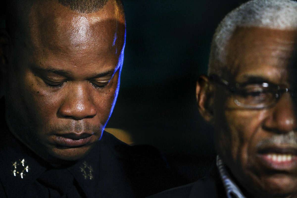 In this Saturday, Aug. 1, 2015, photo, Memphis Police Director Toney Armstrong, left, listens as Mayor A C Wharton, right, holds a news conference at Regional Medical Center after officer Sean Bolton was shot and killed during a traffic stop in Memphis, Tenn. (Mark Weber/The Commercial Appeal via AP)