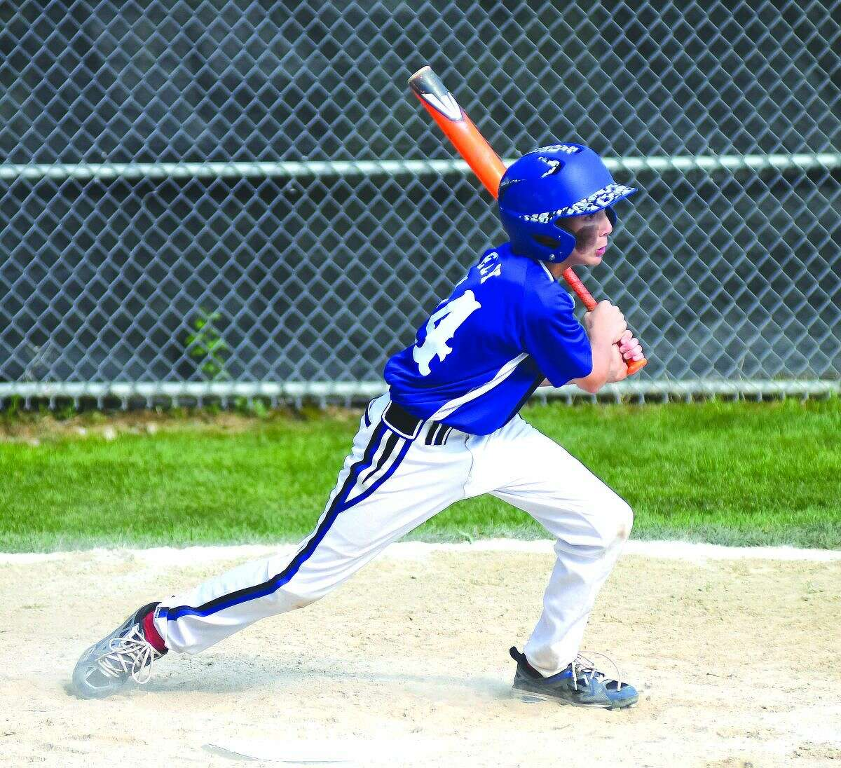 Norwalk's Chris Ely laces a two-run double with the bases loaded during Sunday's Norwalk 11-year-old Cal Ripken New England regional game vs. Swanzey, N.H.., at Keyes Field in Dover, N.H. Norwalk won 5-2 and Ely is 4-for-4 with seven RBIs with the bases loaded through two games.