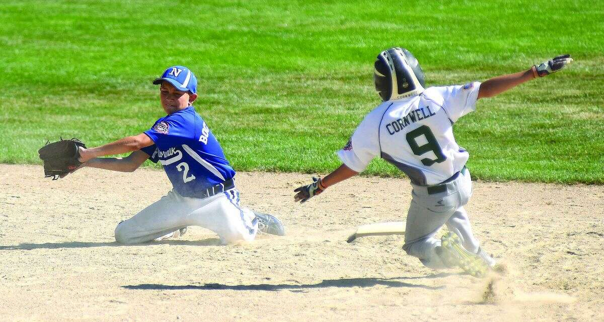Hour photo/John Nash - Norwalk shortstop Ben Boccanfuso snares the ball as a Swanzey baserunner steals second during Sunday's Norwalk 11-year-old Cal Ripken New England regional game vs. Swanzey, N.H.., at Keyes Field in Dover, N.H. Norwalk won 5-2.