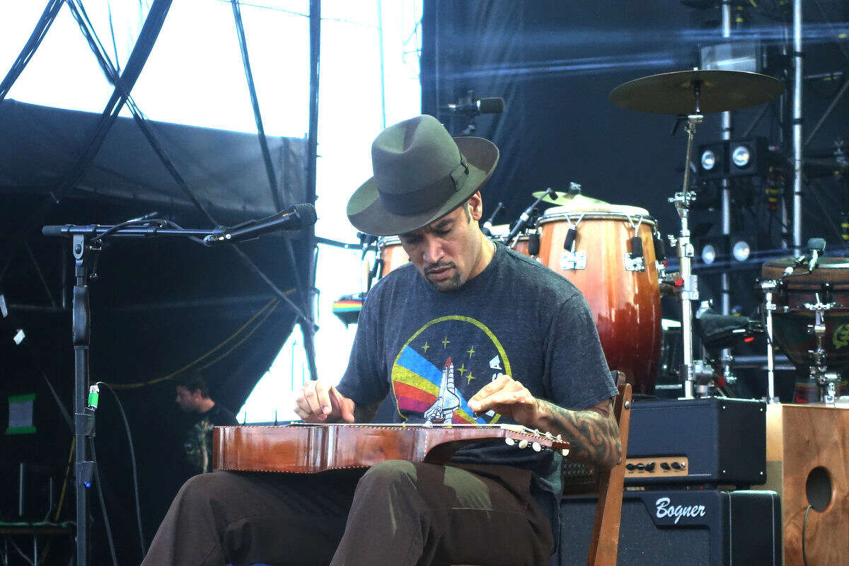 Ben Harper opens his set with a lap tapping acoustic melody at the 20th annual Gathering of the Vibes at Seaside Park in Bridgeport Sunday.