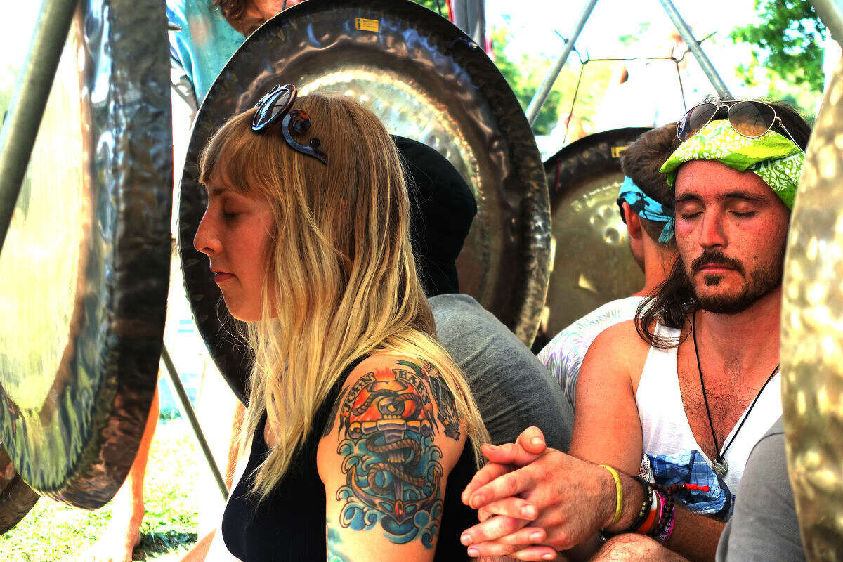 Festival goers form a gong circle during 20th annual Gathering of the Vibes at Seaside Park in Bridgeport Sunday.