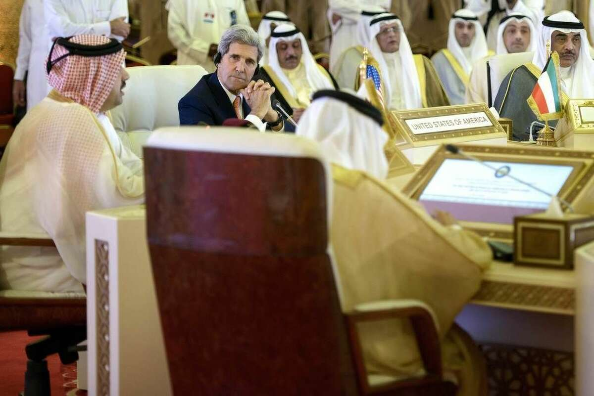 U.S. Secretary of State John Kerry, center, listens during a foreign ministers meeting of the Gulf Cooperation Council, in Doha, Qatar, Monday, Aug. 3, 2015. Kerry is meeting his Gulf Arab counterparts for talks in Qatar as he attempts to ease the concerns of key allies over the Iran nuclear deal. (Brendan Smialowski/Pool Photo via AP)
