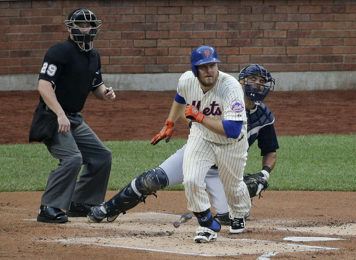 New York Mets first baseman Lucas Duda (21) breaks down the first base line on an RBI base hit to right field which allowed Daniel Murphy to score in the first inning of a baseball game against the Atlanta Braves, Wednesday, July 9, 2014, in New York. (AP Photo/Julie Jacobson)