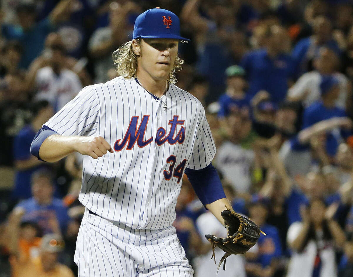 New York Mets starting pitcher Noah Syndergaard reacts after pitching through eight innings of the Mets 5-2 victory over the Washington Nationals during a baseball game in New York, Sunday, Aug. 2, 2015. (AP Photo/Kathy Willens)
