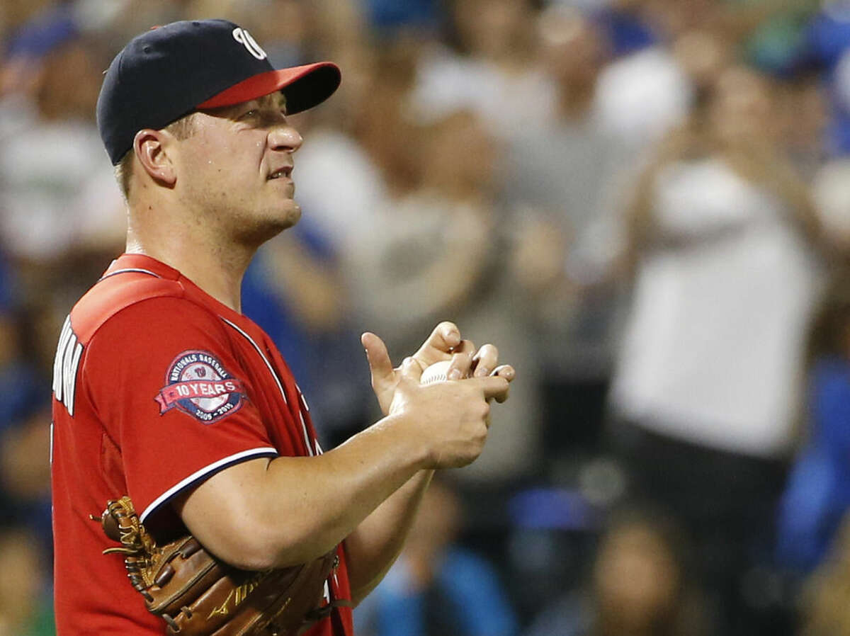 Washington Nationals starting pitcher Jordan Zimmermann rubs up a ball after allowing five runs, including two, two-run home runs in the third inning of a baseball game against the New York Mets in New York, Sunday, Aug. 2 2015. (AP Photo/Kathy Willens)