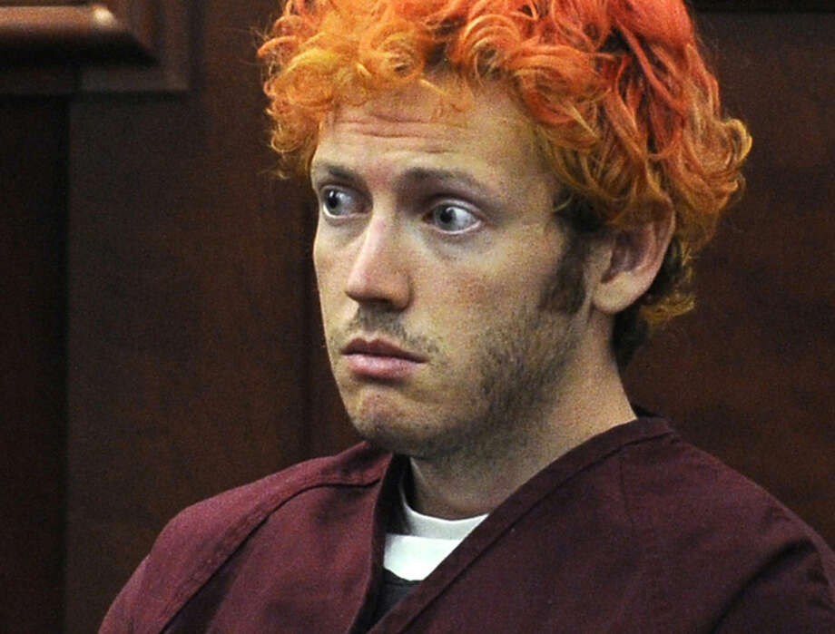 FILE - In this July 23, 2012, file photo, James Holmes, who is charged with killing 12 moviegoers and wounding 70 more in a shooting spree in a crowded theatre in 2012, sits in Arapahoe County District Court in Centennial, Colo. Jurors in the Colorado theater shooting trial reached a decision Monday, Aug. 3, 2015, on whether to keep the death penalty as an option for Holmes. The jury deliberated for less than three hours, starting Thursday after Holmes' parents made an emotional plea for their son's life because he is mentally ill. (RJ Sangosti/The Denver Post via AP, Pool, File)