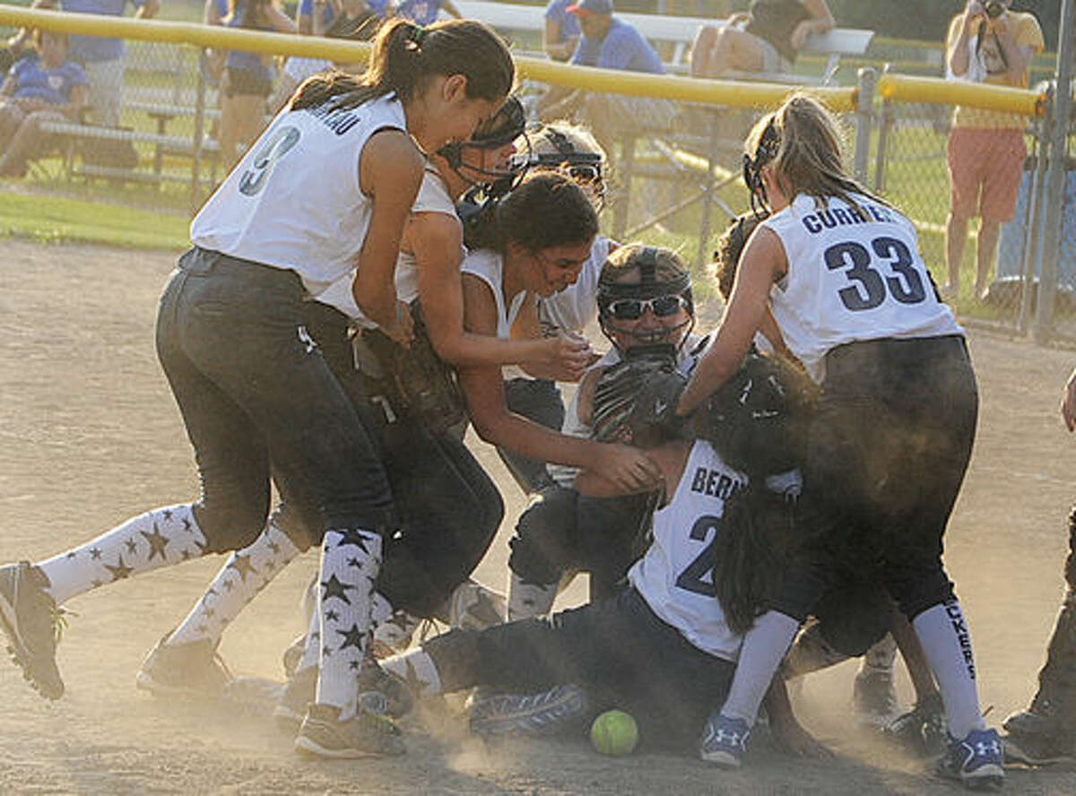 Westport girls softball celebrates in the win against Waterford in the state championship game. Hour photo/Matthew Vinci