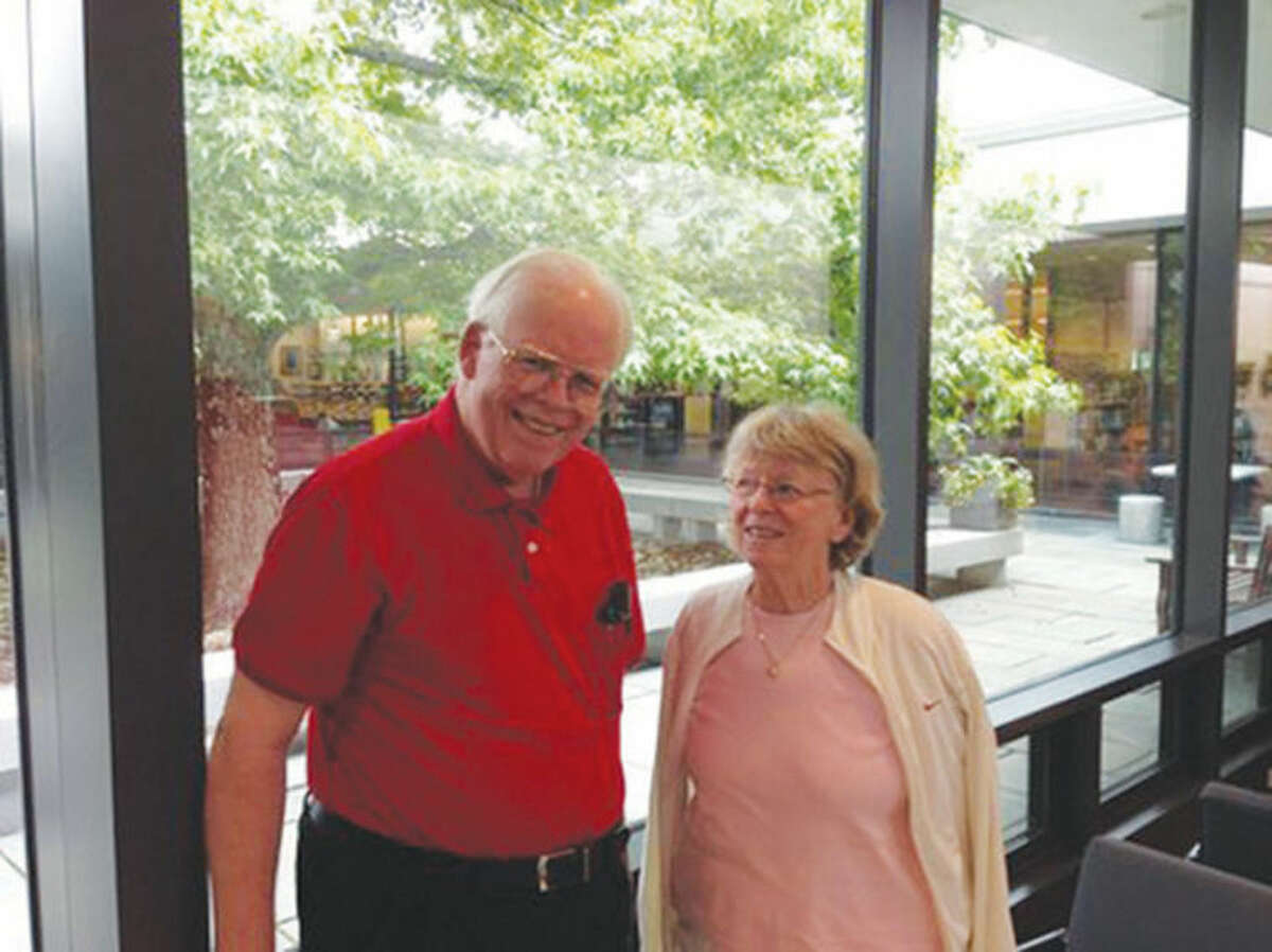 Phil Richards, a founder and former president of Stay At Home in Wilton, poses for a photo with the organization's current president, Barbara Quincy.