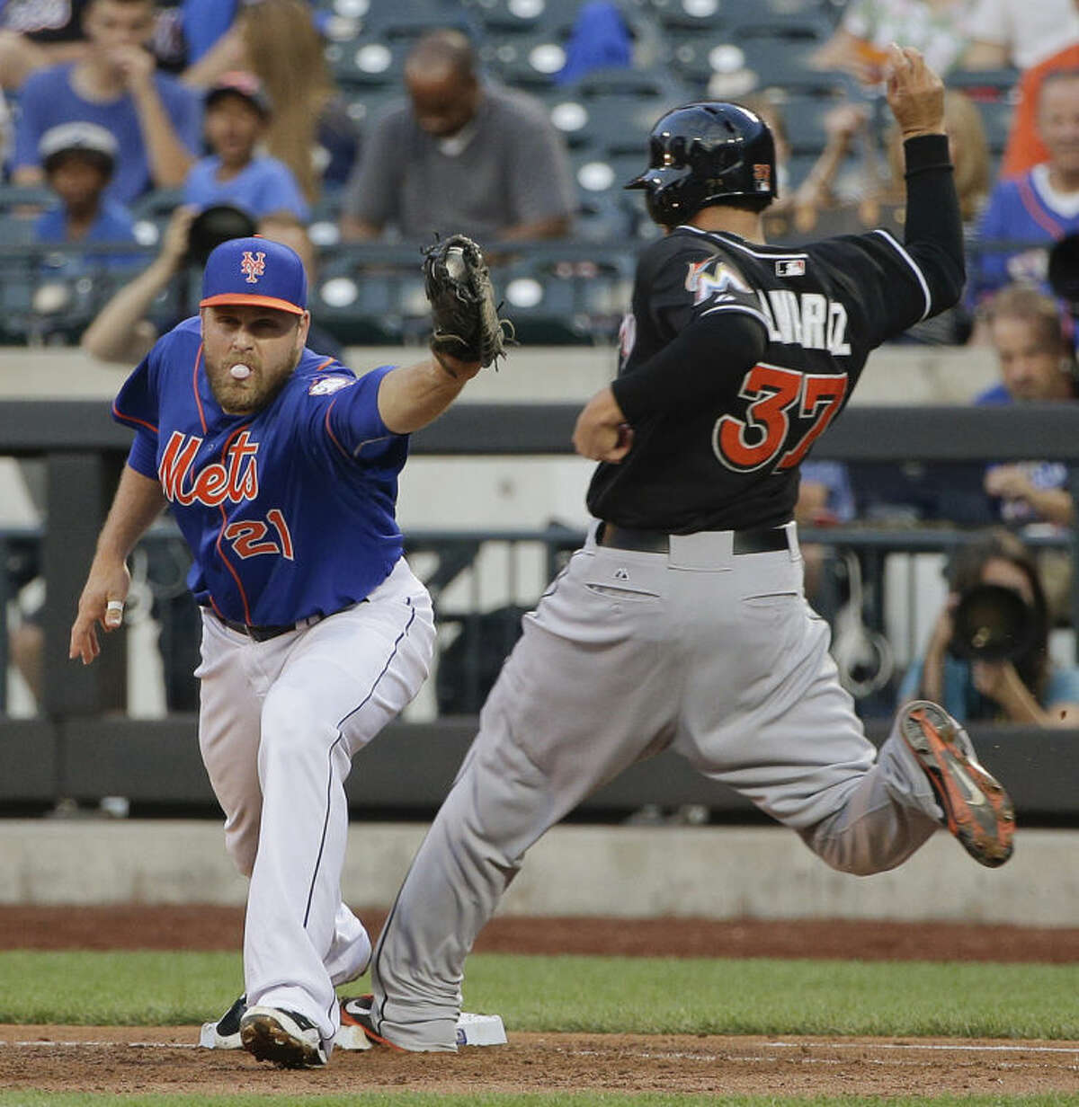 New York Mets first baseman Lucas Duda (21) takes the throw to the bag ahead of Miami Marlins' Henderson Alvarez (37) for an out in the third inning of a baseball game, Friday, July 11, 2014, in New York. (AP Photo/Julie Jacobson)