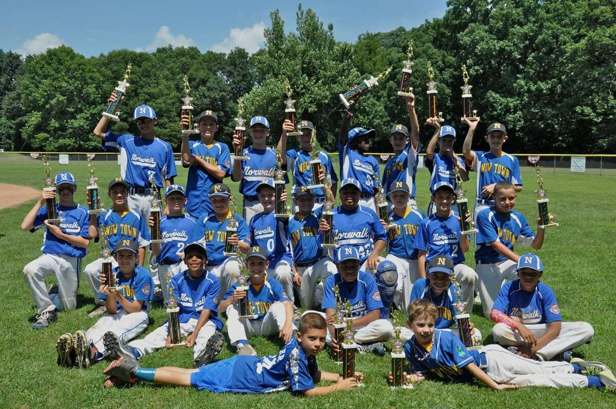 The 11-year-old Cal Rpiken All-Stars from Norwalk and Newtown pose for a group photo after last month's state championship game in Norwalk.
