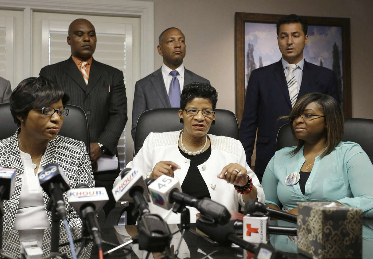 Geneva Reed-Veal, center, mother of Sandra Bland, and her daughters Sharon Cooper, left, and Sierra Cole are backed up by attorneys at a news conference Tuesday, Aug. 4, 2015, in Houston. Bland's family has filed a wrongful-death lawsuit Tuesday against the officer and other officials, saying it was a last resort after being unable to get enough information about the case. Bland, a 28-year-old Chicago-area woman, was found dead in her Waller County jail cell in Hempstead, Texas on July 13. (AP Photo/Pat Sullivan)