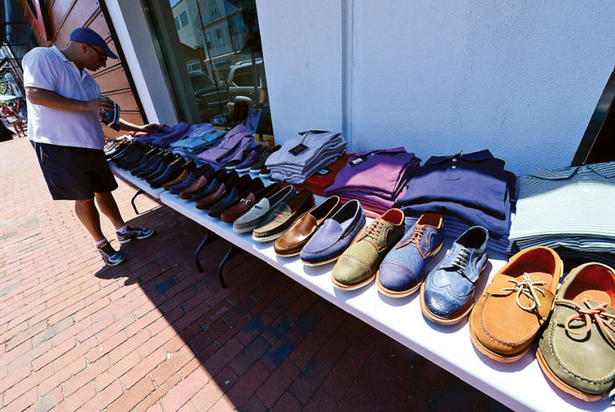 Hour photo / Erik Trautmann Thw Westport Sidewalk sale commences Friday with large crowds coming through sale items along Main St. including merchandise from Allen Edmonds.