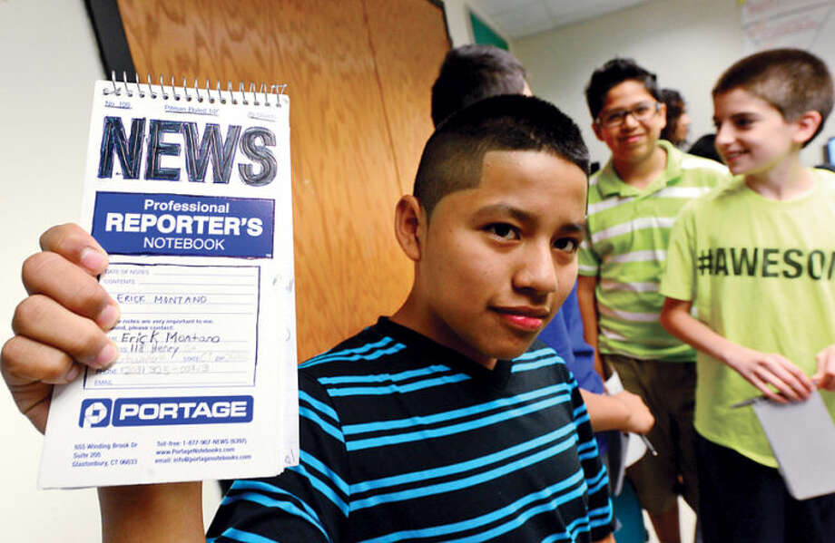Westhill alumni created Project Lede, a summer program that teaches journalism to middle school students, including 12-year-old Erick Montano, during a session at Toquam Magnet School Friday. The program also teaches the middle schoolers how to create a student newspaper.