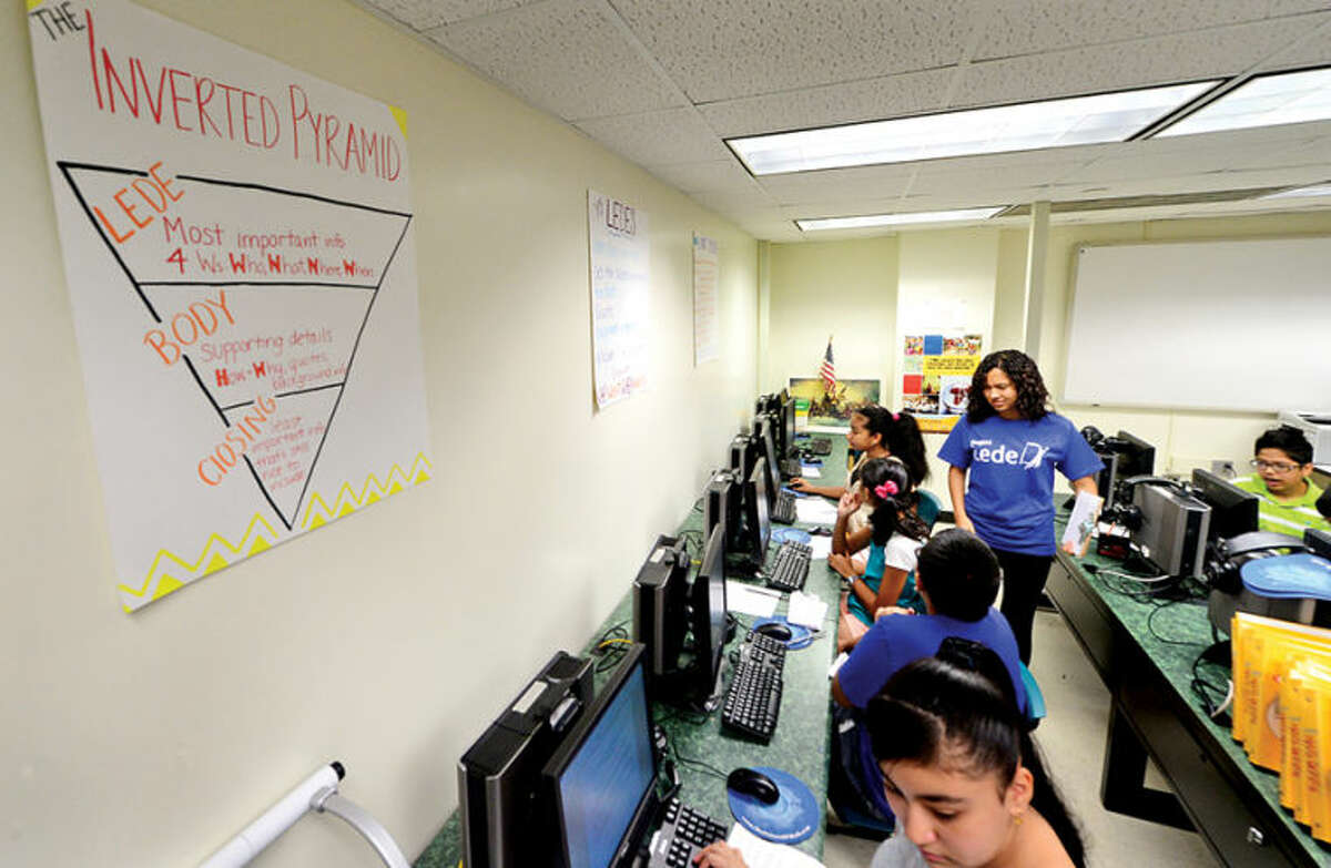 Westhill High School alumni created Project Lede, a summer program that teaches journalism to middle school students at Toquam Magnet School Friday. The program also teaches the middle schoolers how to create a student newspaper.