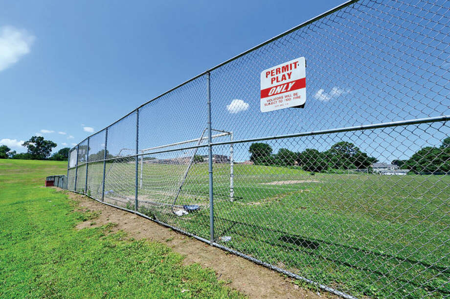 Hour photo / Erik Trautmann The Norwalk Zoning Commission may vote next Wednesday on a plan for athletic field lighting for Nathan Hale Middle School. Some neighbors are frowing upon the proposal.
